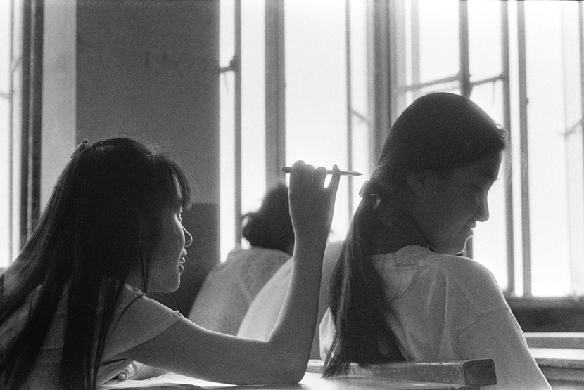 1994: I captured this little interaction between classmates Zhou Huixuan and Tao Jing.