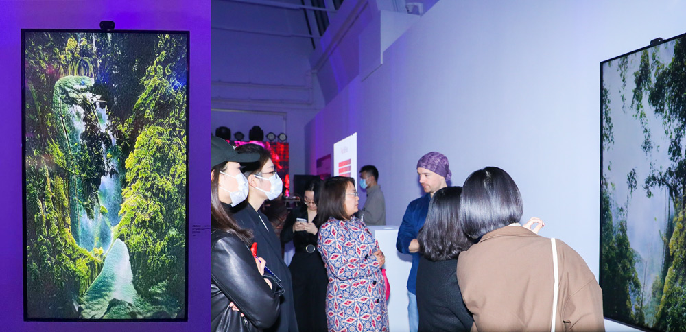 """Left: Celyn Bricker's work """"After the Rain""""; Right: Celyn Bricker introduces his work to visitors at the exhibition, at UCCA, Beijing, March 2021. Courtesy of BCA"""