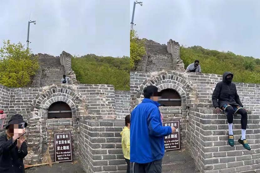 """Photos show two foreigners behind and atop a section of the Great Wall with a bilingual """"no crossing"""" sign displayed in front. From @北京慕田峪长城旅游服务有限公司 on Weibo"""