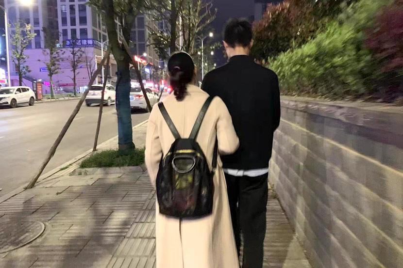 Chen Sihan and his mother Li Ronghui walk down a street in Guizhou province, 2021. Courtesy of Han Qian