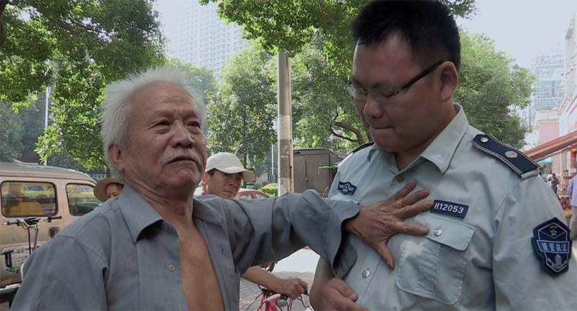 A screenshot from the film shows Wang Tiancheng clashing with an urban management officer. Courtesy of Dai Nianwen