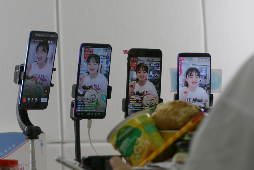 A livestreamer promotes local delicacies from Heihe, Heilongjiang province, July 2020. People Visual
