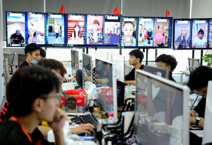 Staff work at an MCN agency in Fujian province, 2020. The monitors show livestream shows taking currently underway. Wang Dongming/CNS/People Visual