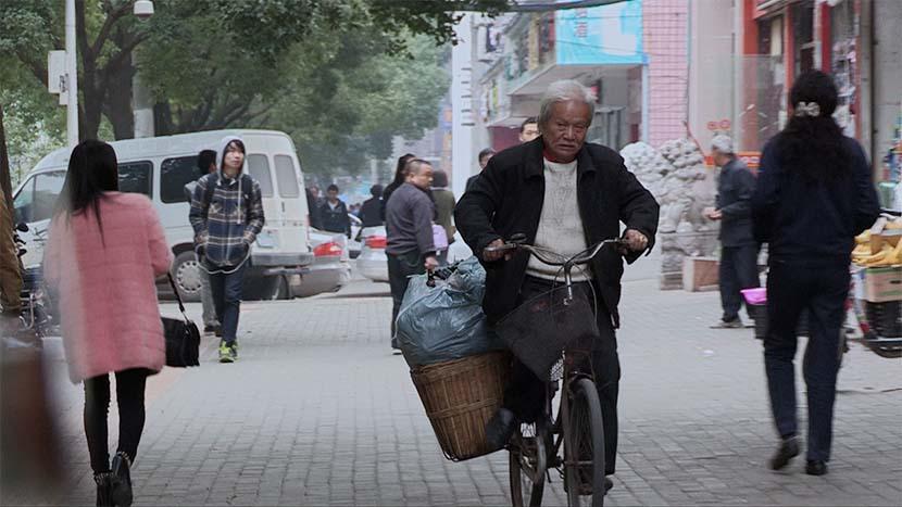 A screenshot from the film shows Wang Tianchen riding a bike. Courtesy of Dai Nianwen