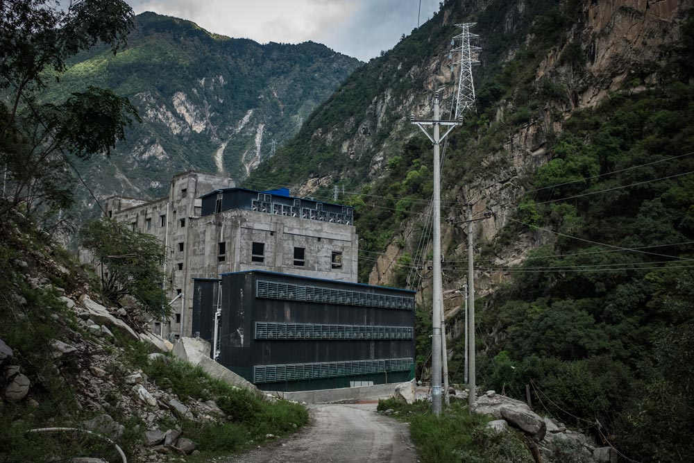 An exterior view of a bitcoin mine near a hydropower station in rural Sichuan province, 2016. Liu Xingzhe/People Visual