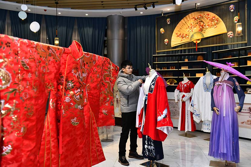 """A man works at his """"hanfu"""" studio in Cao County, Shandong province, Dec. 12, 2020. Xinhua"""