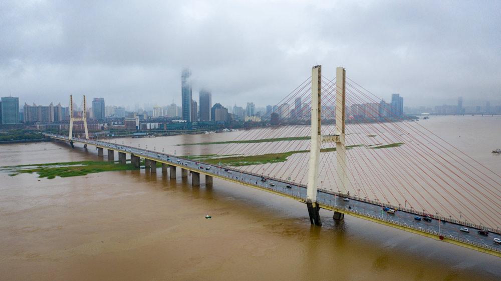 Heavy rainfall has filled the Gan River in Nanchang, Jiangxi province, May 23, 2021. People Visual