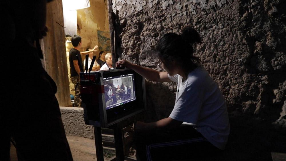 "Li Dongmei on the set of ""Mama."" Courtesy of Li Dongmei"