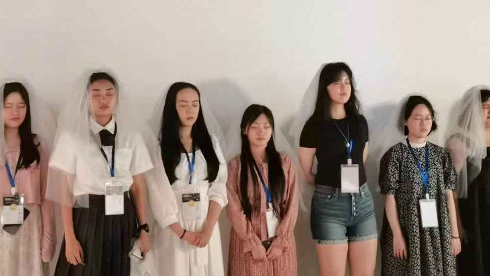 """A group of women take part in a """"self-marriage ceremony"""" during the exhibition """"Anti Body-Shaming,"""" in Shanghai, May 2021. Courtesy of Zhang"""
