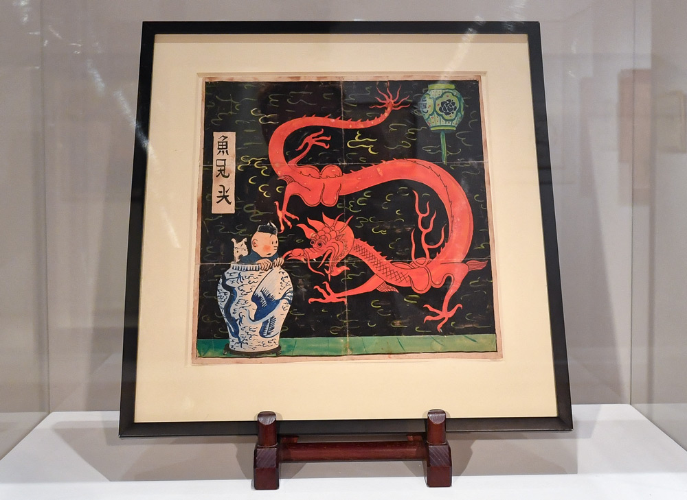 """The original cover for """"The Blue Lotus"""" on display at Artcurial Auction House, in Paris, France, Jan. 12, 2021. Hergé created the artwork for the initial cover in 1936. Lionel Urman/ABACAPRESS.COM via People Visual"""