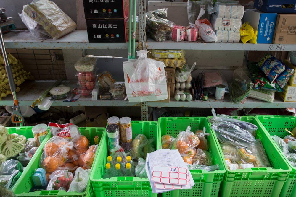 Groceries sit waiting to be sorted at Jin Liangliang's booth in Wuhan, Hubei province, April 25, 2021. Wu Peiyue for Sixth Tone