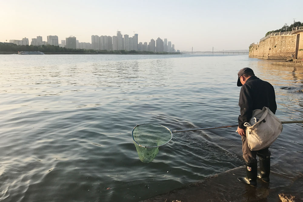 A man fishes by the Xiang River in Chanhgsha, Hunan province, April 2018. Courtesy of Yang Xiao