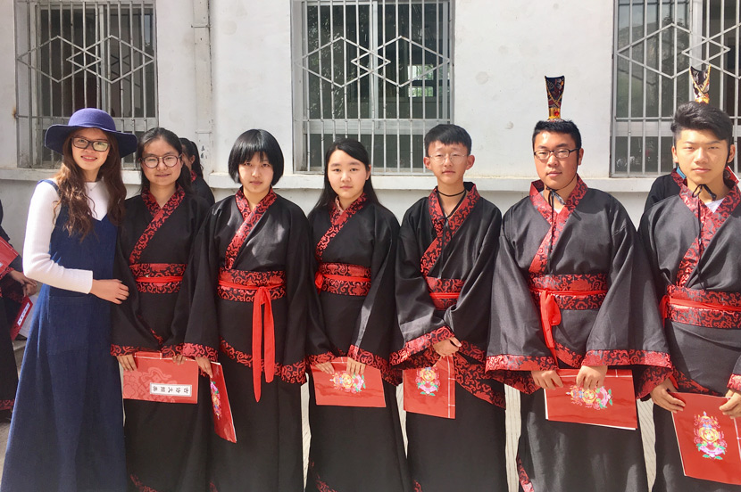 Zhang Min and her students pose for a photo during an activity at Lhasa High School, Tibet Autonomous Region, June 17, 2017. Courtesy of Zhang Min