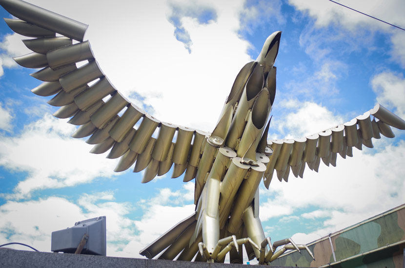 An eagle statue made of shell cases is displayed near Baotou Northern Weaponry City in Baotou, Inner Mongolia Autonomous Region, Jan. 1, 2012. Courtesy of Wang Ziyan