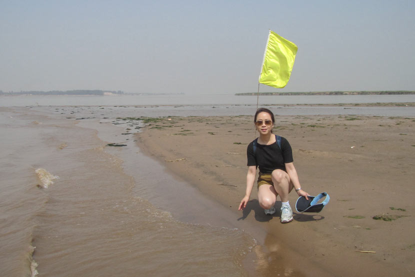 Zhang Ling poses for a photo on the bank of the Yellow River in Hebei province, May 21, 2013. Courtesy of Zhang Ling