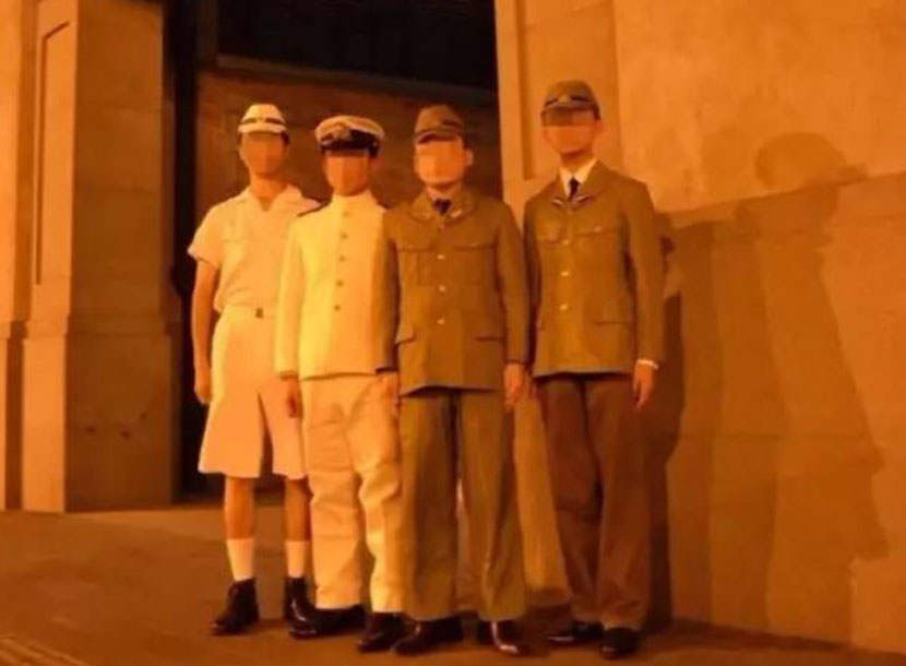 Four men dressed in WWII-era Japanese military uniforms pose for a photo in front of the Sihang Warehouse War Memorial Hall in Shanghai, Aug. 7, 2017. From Weibo user 'ShanghaiZhiying_5ZN'