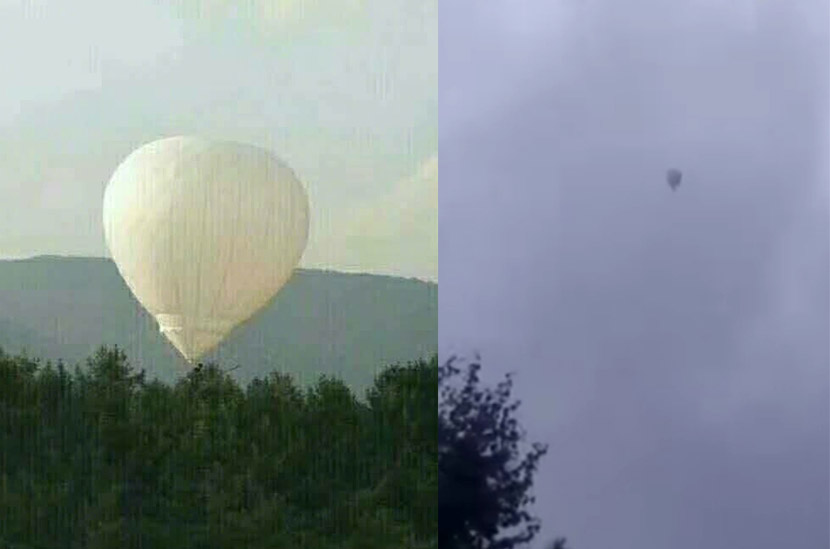 Screenshots from video footage shot at the scene show the balloon aloft. From the Weibo account of the Beijing Youth Daily