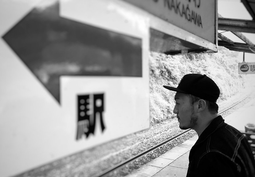 Hu Boyu poses for a photo at a railway station during his trip to Japan, Oct. 21, 2016. Courtesy of Hu Boyu