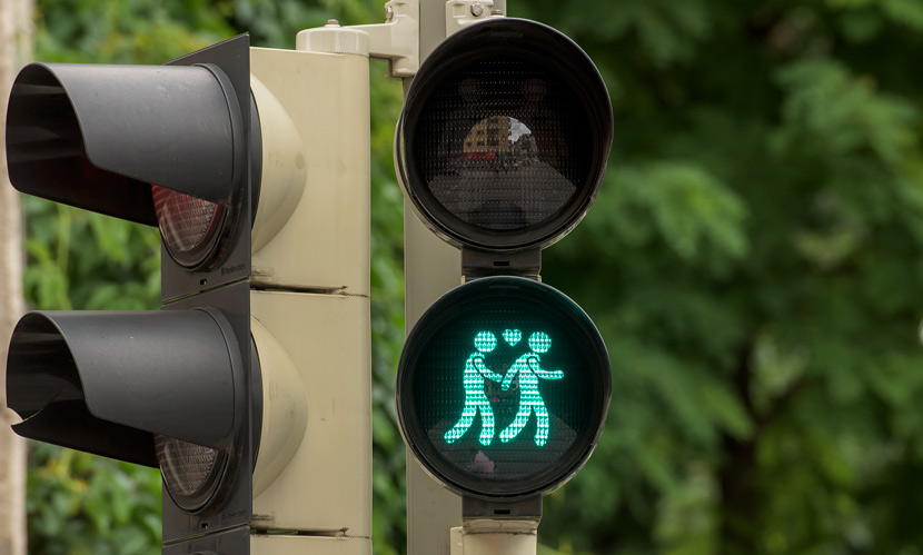 A pedestrian crossing signal shows a gay couple at an intersection in Munich, Germany, July 14, 2015. Joerg Koch/Getty Images/VCG
