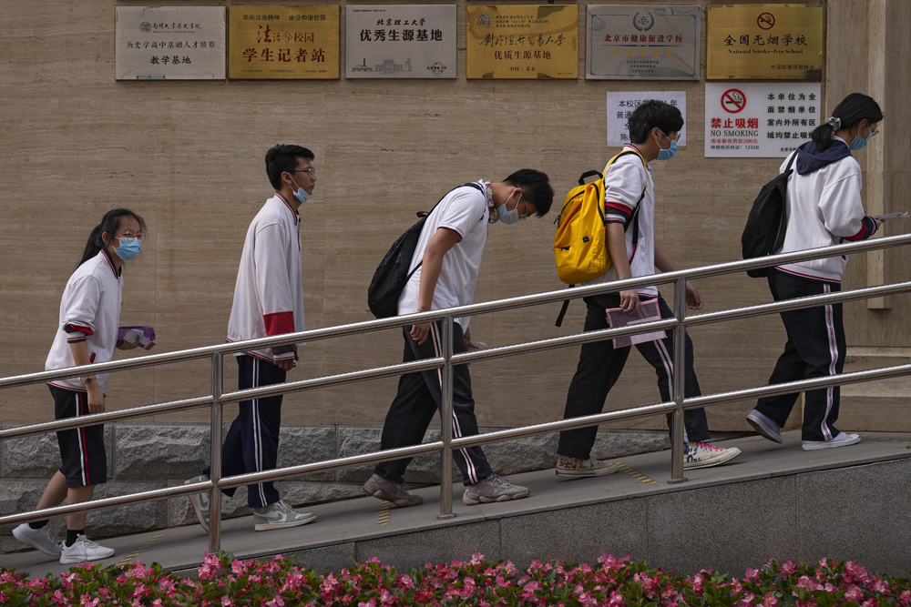 Students enter an examination site in Beijing, June 7, 2021. People Visual
