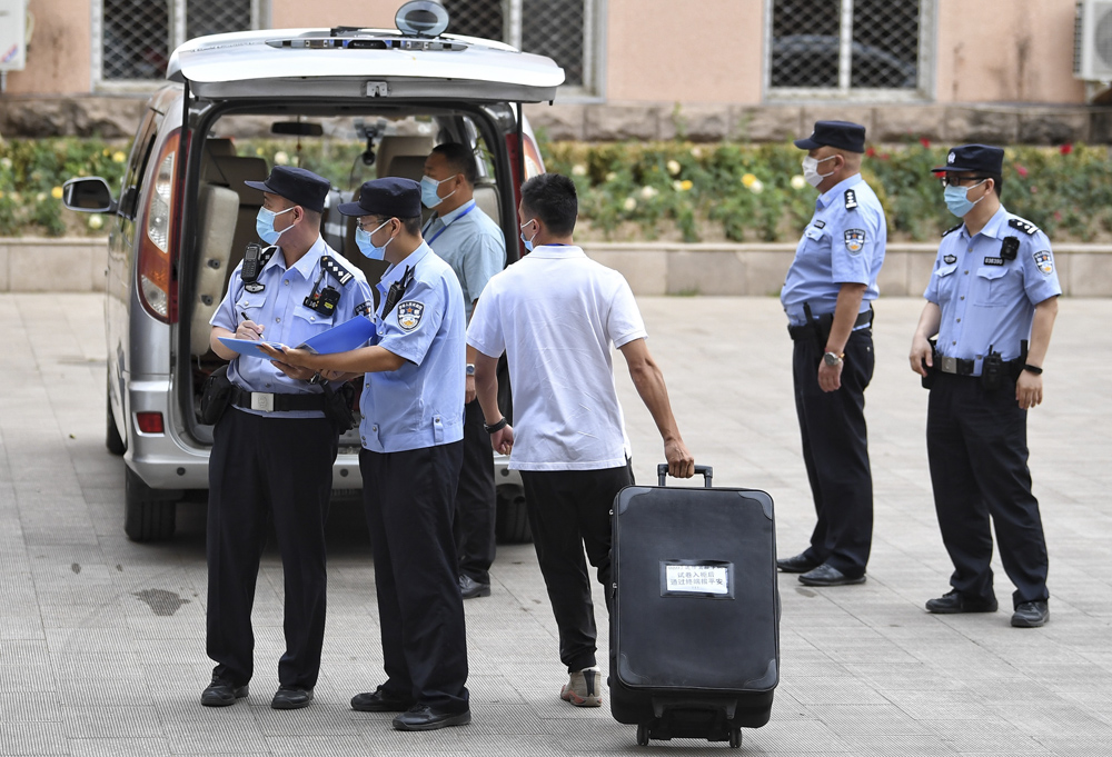 """Under police supervision, """"gaokao"""" test papers are transferred to a vehicle in Beijing, June 7, 2021. People Visual"""