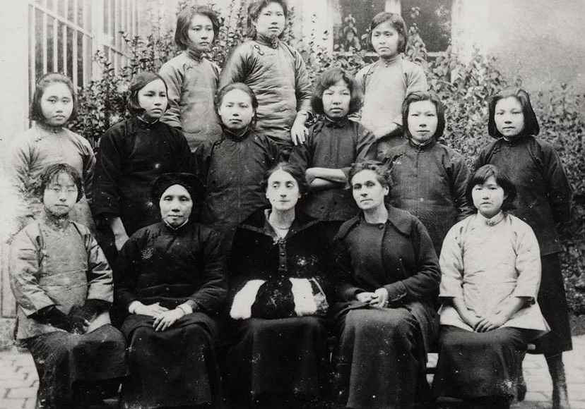 A group photo of female Chinese students and French teachers in Montargis, France, 1920. Ge Jianhao is seated in the front row, second from left. Her daughter Cai Chang is standing in the second row, far right. From Women Today Weekly