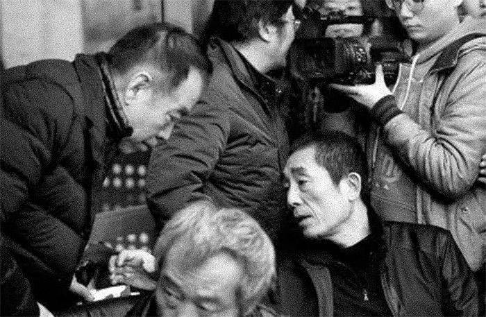 Chen Kaige (left), Tian Zhuanghuang (front bottom), and Zhang Yimou (right bottom) attend a memorial for director Wu Tianming, in Beijing, March 2014. From Oriental Morning Post