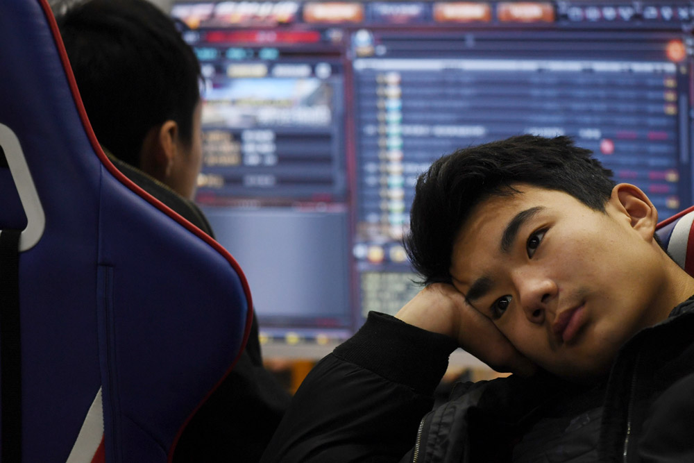 A student listens to a teacher explain gaming techniques in an esports class at the Lanxiang Technical School in Jinan, Shandong province, 2018. Greg Baker/AFP via People Visual
