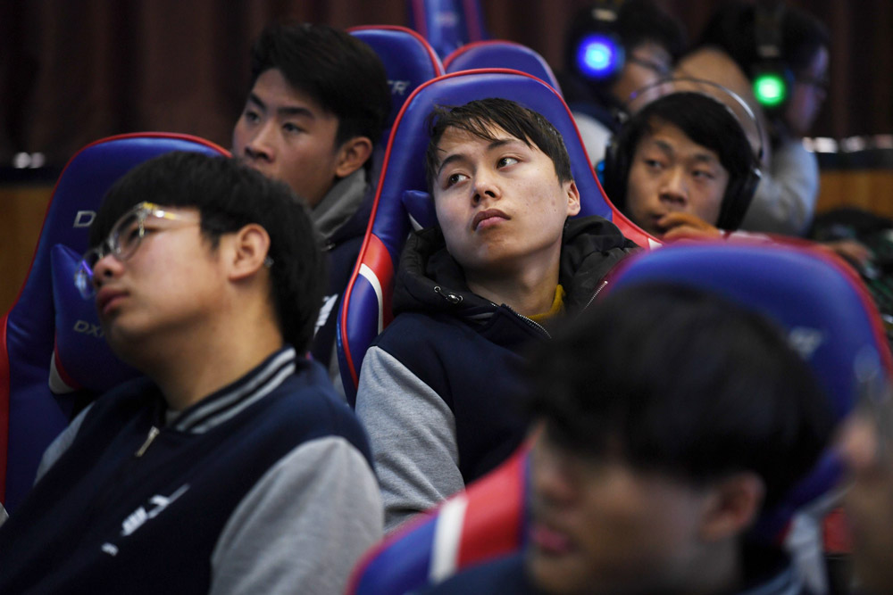Students listen to a teacher explain gaming techniques in an esports class at the Lanxiang Technical School in Jinan, Shandong province, 2018. Greg Baker/AFP via People Visual