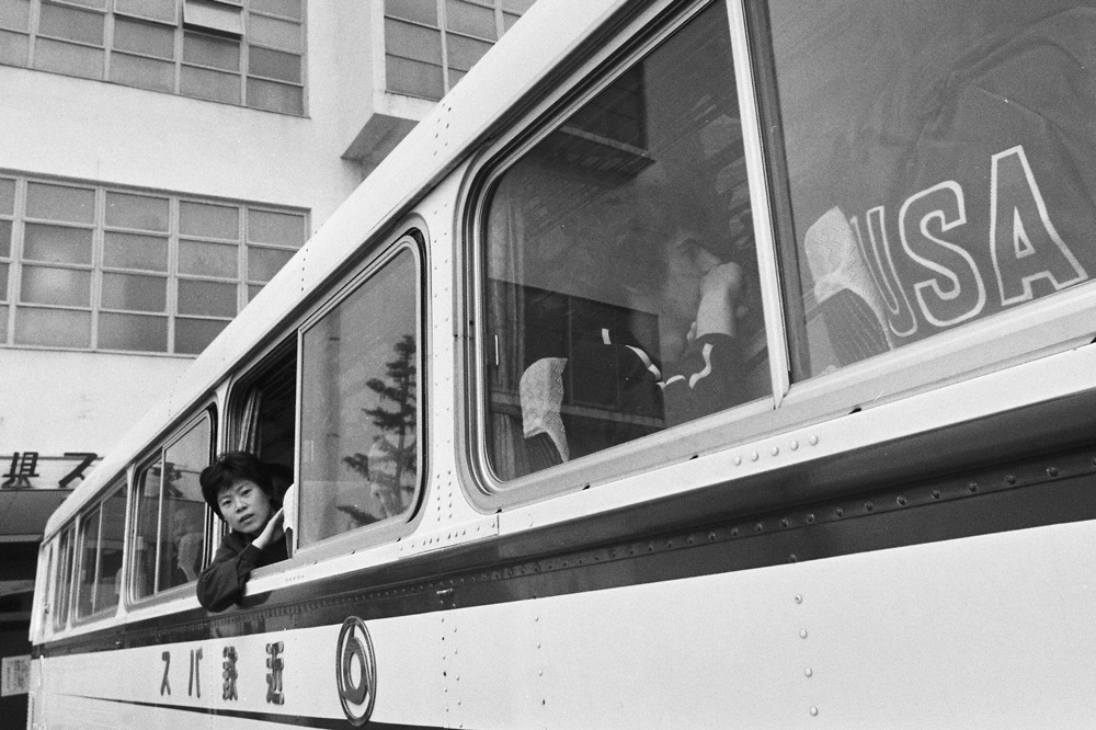 Glenn Cowan (right) of the United State is seen sitting on the Chinese team bus during the 31st World Table Tennis Championships in Nagoya, Aichi, Japan, April 4, 1971. The Asahi Shimbun via Getty Images