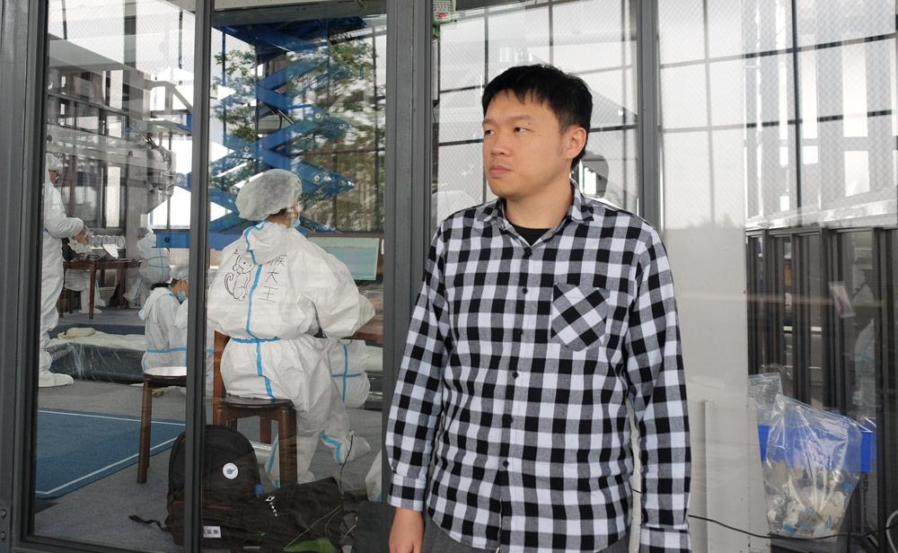 Xu Feihong stands outside the dig site in Sanxingdui, Sichuan province, April 2021. Ye Ruolin/Sixth Tone