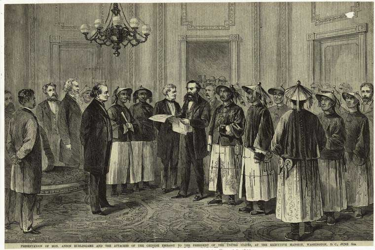 """A 1868 image shows Anson Burlingame and his fellow Chinese envoys. The caption reads """"Presentation of Hon, Anson Burlingame and the attaches of the Chinese embassy to the President Andrew Johnson at the Executive Mansion, Washington, DC, June 5th."""" Courtesy of New York Public Library Digital Gallery"""