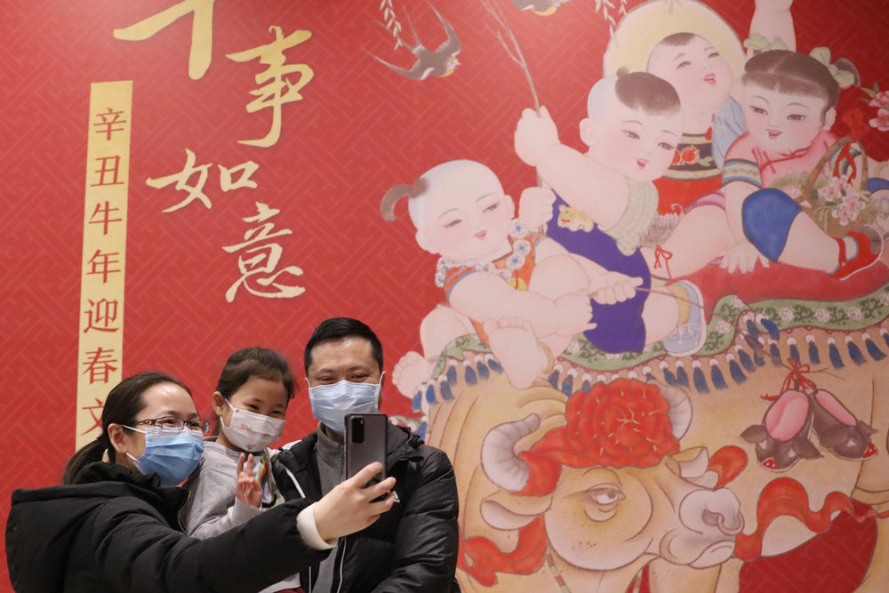 A family takes a selfie in Beijing, Feb. 10, 2021. People Visual