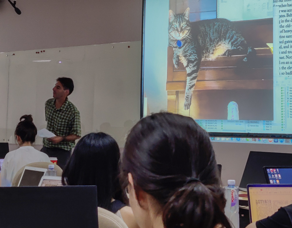 Peter Hessler shows a photo of his pet cat during his last class at Sichuan University, July 1, 2021. Courtesy of He Yujia