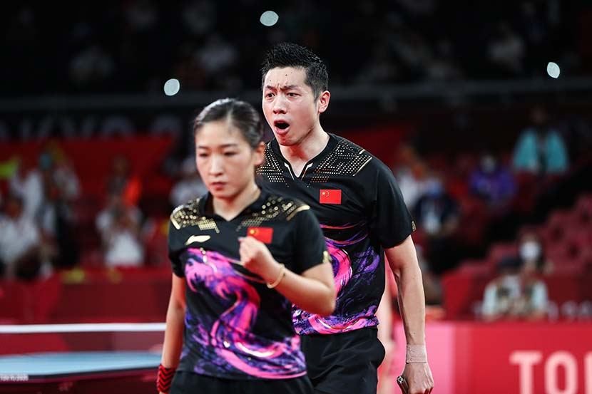 Xin Xu (right) and Shiwen Liu of China during the Mixed Doubles Gold Medal Table Tennis Match China vs Japan of the Tokyo 2020 Olympic Games at the Tokyo Metropolitan Gymnasium arena in Tokyo, Japan, July 26, 2021. People Visual