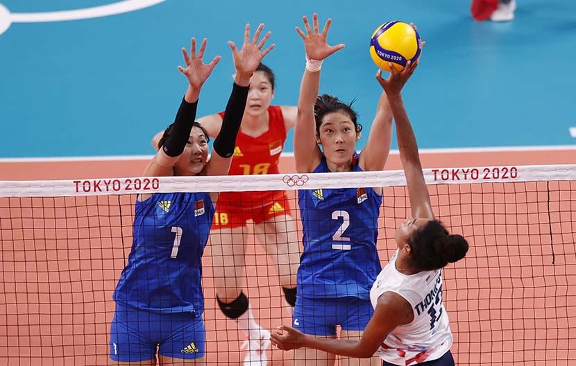 Zhu Ting of China (second from right) tries to stop the ball in the women's volleyball preliminary round pool B match against the United States during the Volleyball events of the Tokyo 2020 Olympic Games at the Ariake Arena in Tokyo, Japan, 27 July 27, 2021. People Visual