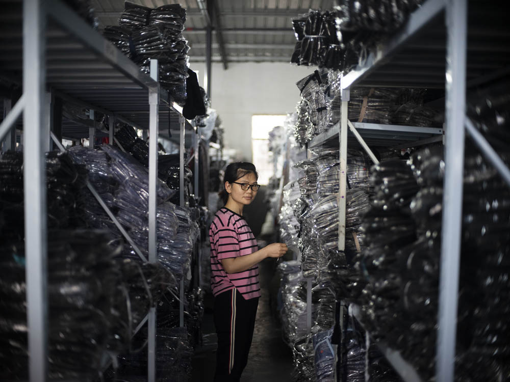 Cao Wei is responsible for packing and dispatching in the factory, June 2021. Courtesy of Lü Meng