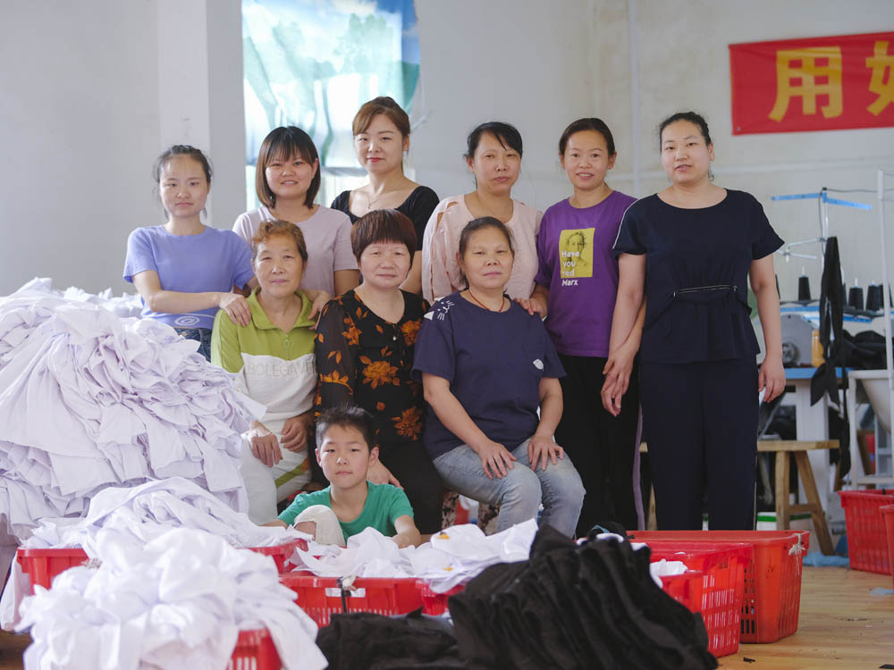 The Plus Ten factory workers consider each other sisters, and will often help colleagues pick up their children, June 2021. Courtesy of Lü Meng