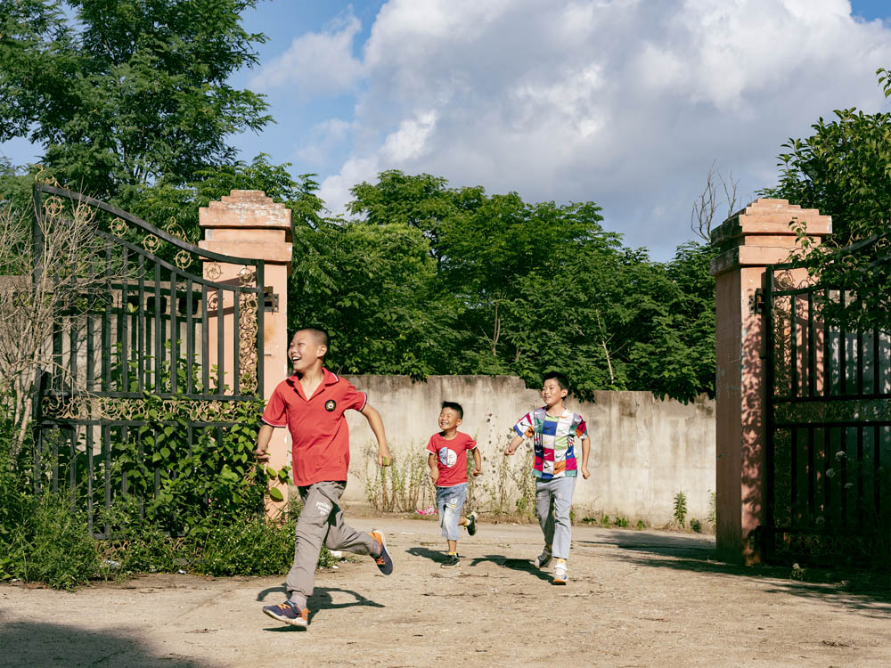 Children run and play in the courtyard of the Plus Ten factory, June 2021. Courtesy of Lü Meng