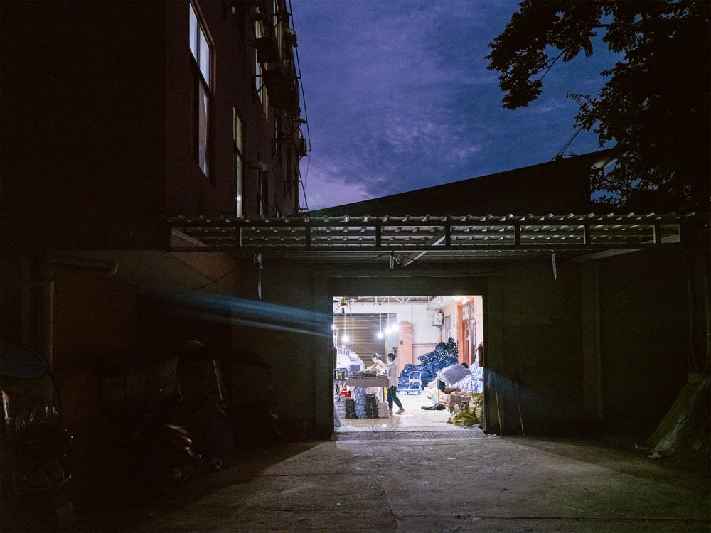Work continues after nightfall at the Plus Ten factory, June 2021. Courtesy of Lü Meng