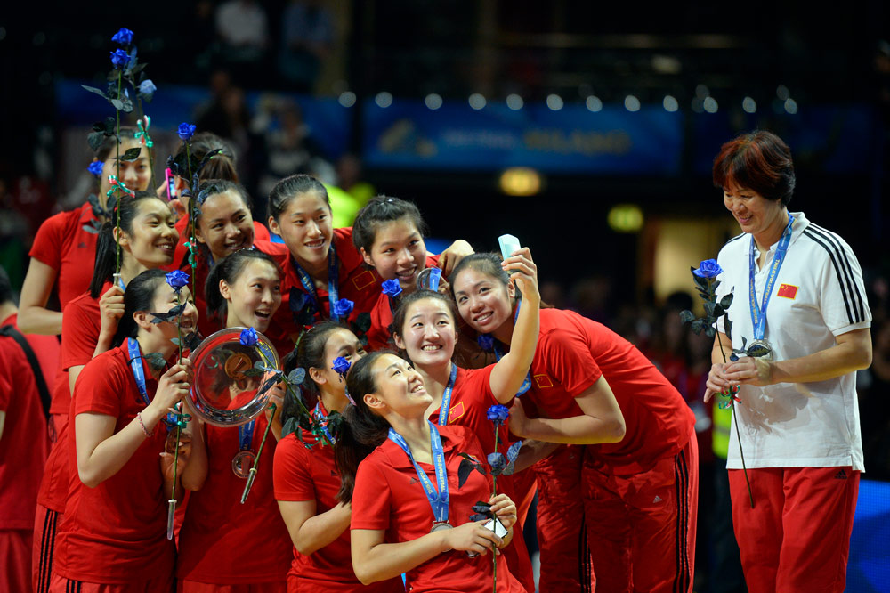 Chinese women's volleyball team members take a selfie celebrating their silver medal at the Volleyball Women's World Championship in Milan, Italy, Oct. 12, 2014. Olivier Morin/AFP via People Visual