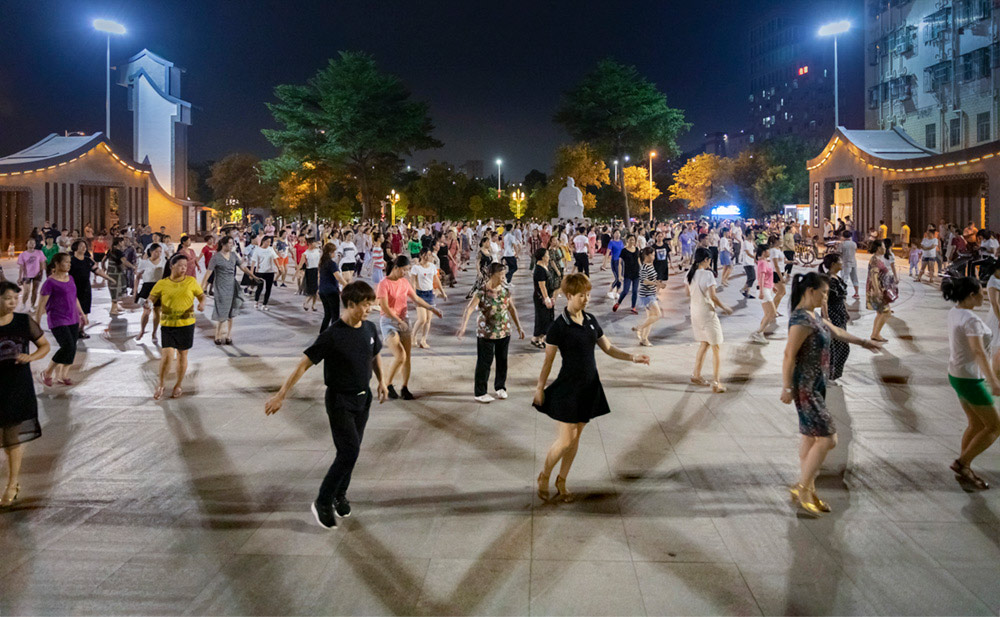 People dance at a square in Shenzhen, Guangdong province, 2019. Zhong Yiwu/People Visual