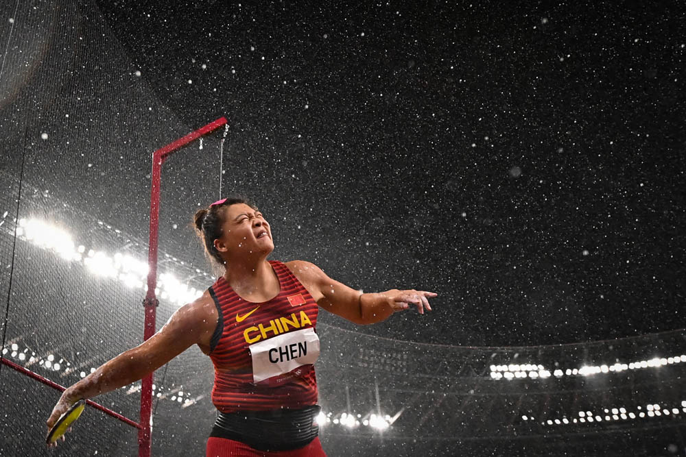 Chen Yang competes in the women's discus throw final, Aug. 2, 2021. Ben Stansall/AFP via People Visual