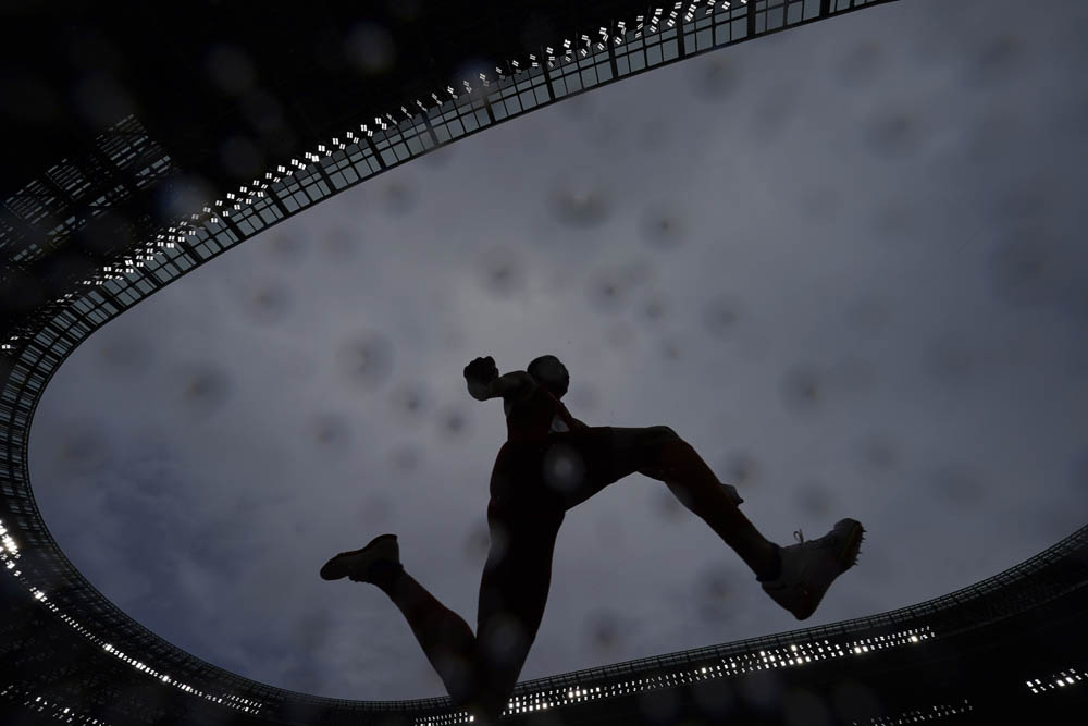 Zhu Yaming competes in the men's triple jump event, Aug. 3, 2021. David J. Phillip/AP via People Visual