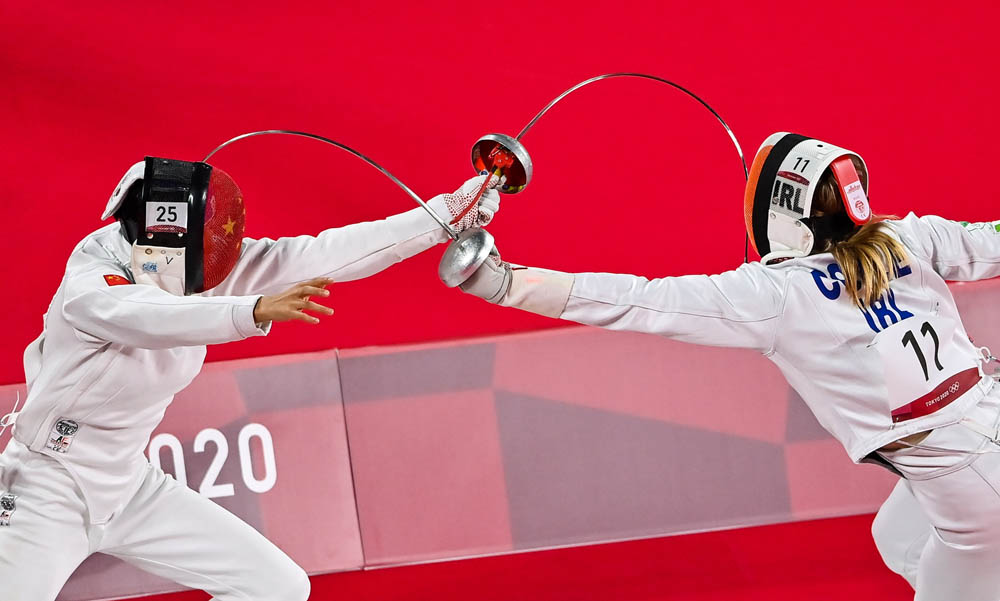 Zhang Xiaonan of China (left) in action against Natalya Coyle of Ireland in the women's individual fencing event, Aug. 5, 2021. Brendan Moran/Sportsfile via People Visual