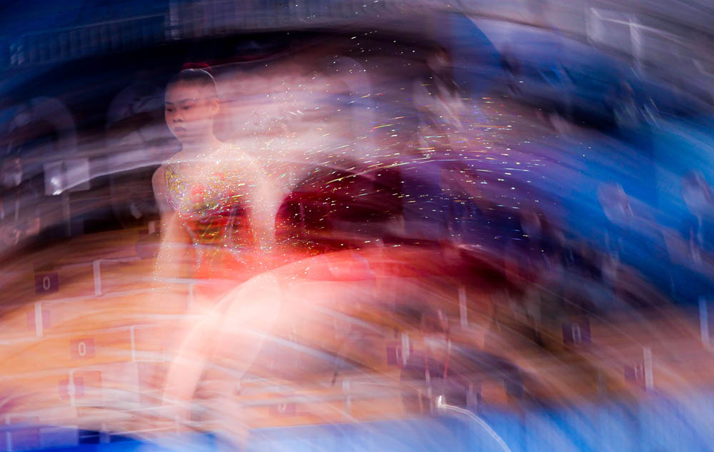 Guan Chenchen competes during the women's balance beam final, Aug. 3, 2021. Amin Mohammad Jamali via People Visual