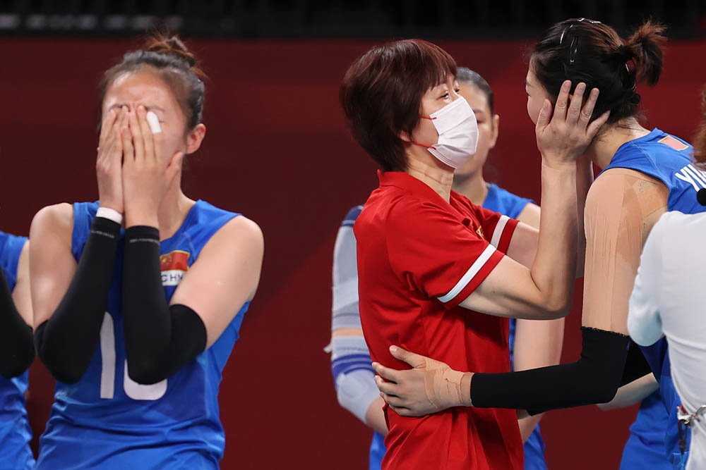 Coach Lang Ping (in red) embraces Yuan Xinyue after the Chinese women's volleyball team's defeat of Argentina, Aug. 2, 2021. Toru Hanai via People Visual