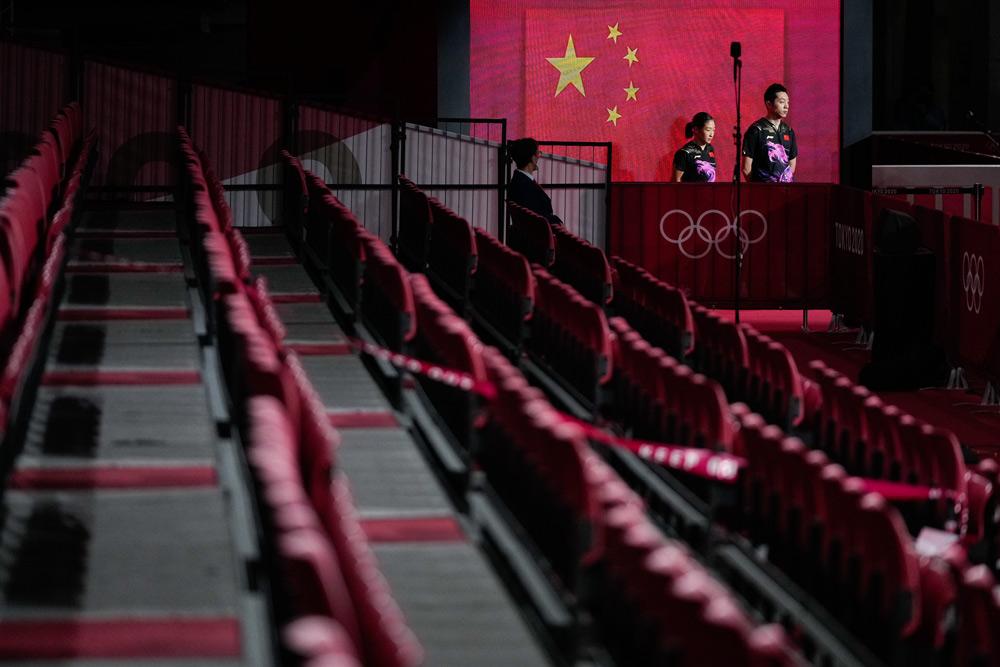 Liu Shiwen and Xu Xin at the mixed doubles table tennis final, July 26, 2021. Wei Zheng/Sportsphoto/People Visual