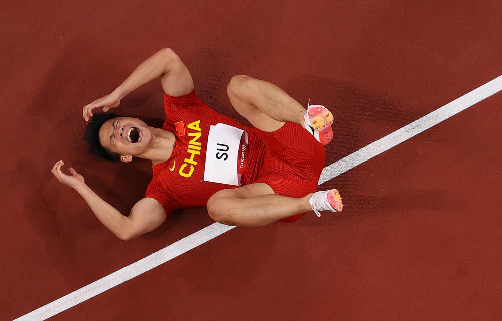 Sprinter Su Bingtian celebrates after winning his men's 100-meter semi-final, Aug. 1, 2021. Richard Heathcote via People Visual