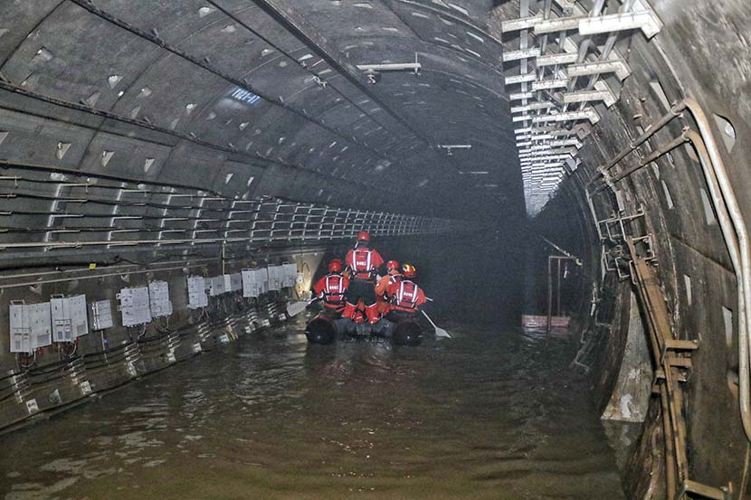 Rescue workers check the tunnel of Line 5 in Zhengzhou, Henan province, July 26, 2021. People Visual